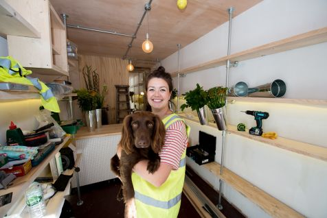 Hayley Wright from The Mighty Quinns Flower Emporium with her dog Daisy
